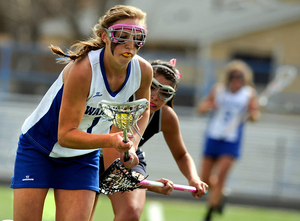 """Centaurus High School's Sarah Brown gains control of the ball on Saturday, April 23, during a lacrosse game against Columbine High School at Centaurus High School. Centaurus won the game 20-12. For more photos go to  <a href=""""http://www.dailycamera.com"""">http://www.dailycamera.com</a><br /> Jeremy Papasso/ Camera"""