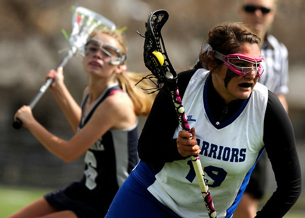 """Centaurus High School's Mariah Kline charges towards the goal on Saturday, April 23, during a lacrosse game against Columbine High School at Centaurus High School. Centaurus won the game 20-12. For more photos go to  <a href=""""http://www.dailycamera.com"""">http://www.dailycamera.com</a><br /> Jeremy Papasso/ Camera"""