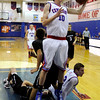"Centaurus High School's Steven Jordan snags a rebound during a game against D'Evelyn High School on Saturday, Dec. 17, at Centaurus. D'Evelyn won the game 81-64. For more photos of the game go to  <a href=""http://www.dailycamera.com"">http://www.dailycamera.com</a><br /> Jeremy Papasso/ Camera"