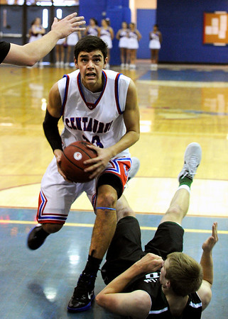 "Centaurus High School's Austin Tunquist drives to the hoop during a game against D'Evelyn High School on Saturday, Dec. 17, at Centaurus. D'Evelyn won the game 81-64. For more photos of the game go to  <a href=""http://www.dailycamera.com"">http://www.dailycamera.com</a><br /> Jeremy Papasso/ Camera"