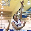 "Centaurus High School's Steven Jordan takes a shot during a game against D'Evelyn High School on Saturday, Dec. 17, at Centaurus. D'Evelyn won the game 81-64. For more photos of the game go to  <a href=""http://www.dailycamera.com"">http://www.dailycamera.com</a><br /> Jeremy Papasso/ Camera"