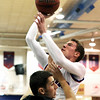 "Centaurus High School's Nate McGinley takes a shot over Reid Bervik during a game against D'Evelyn High School on Saturday, Dec. 17, at Centaurus. D'Evelyn won the game 81-64. For more photos of the game go to  <a href=""http://www.dailycamera.com"">http://www.dailycamera.com</a><br /> Jeremy Papasso/ Camera"