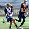 LACROSSE<br /> Emma Lazaroff of Centaurus drives to the goal while being guarded by Reece Briner of Heritage.<br /> Photo by Marty Caivano/March 29, 2011