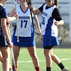 LACROSSE<br /> Gabby Wallace, left, and Emma Lazaroff celebrate a goal against Heritage.<br /> Photo by Marty Caivano/March 29, 2011