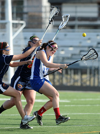 LACROSSE<br /> Gabby Wallace of Centaurus gets heavy pressure from Madison Hosack, left, and Reece Briner of Heritage.<br /> Photo by Marty Caivano/March 29, 2011