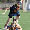 LACROSSE<br /> Sarah Brown of Centaurus takes down Megan Larson of Heritage.<br /> Photo by Marty Caivano/March 29, 2011