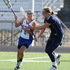 LACROSSE<br /> Montana Fels of Centaurus evades Hannah Annalora of Heritage.<br /> Photo by Marty Caivano/March 29, 2011