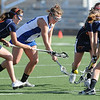 LACROSSE<br /> Carley Dvorak of Centaurus, center, fights for the ball against Heritage players.<br /> Photo by Marty Caivano/March 29, 2011