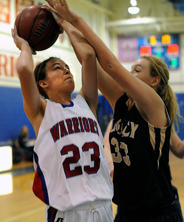 """Centaurus High School's Anna Hubbell drives to the hoop past Courtney Smith on Saturday, Dec. 10, during the Boulder Valley Invitational finals against Legacy High School at Centaurus. Legacy won the game 53-49. For more photos of the game go to  <a href=""""http://www.dailycamera.com"""">http://www.dailycamera.com</a><br /> Jeremy Papasso/ Camera"""