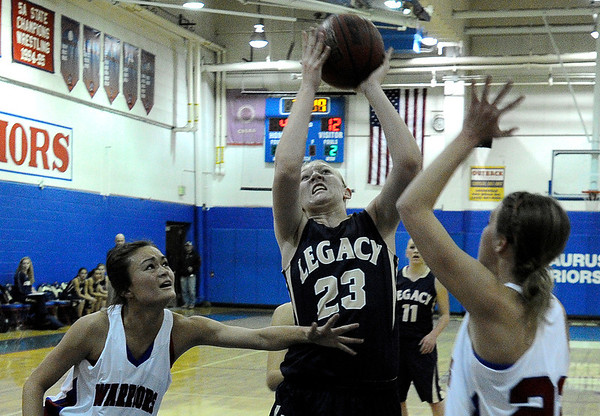 "Legacy High School's Caitlyn Smith takes a shot over Centaurus High School's Anna Hubbell, right, on Saturday, Dec. 10, during the Boulder Valley Invitational finals at Centaurus. Legacy won the game 53-49. For more photos of the game go to  <a href=""http://www.dailycamera.com"">http://www.dailycamera.com</a><br /> Jeremy Papasso/ Camera"