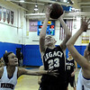 """Legacy High School's Caitlyn Smith takes a shot over Centaurus High School's Anna Hubbell, right, on Saturday, Dec. 10, during the Boulder Valley Invitational finals at Centaurus. Legacy won the game 53-49. For more photos of the game go to  <a href=""""http://www.dailycamera.com"""">http://www.dailycamera.com</a><br /> Jeremy Papasso/ Camera"""