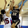 """Legacy High School's Kailey Edwards drives to the hoop past Centaurus High School's Midori Patterson on Saturday, Dec. 10, during the Boulder Valley Invitational finals at Centaurus. Legacy won the game 53-49. For more photos of the game go to  <a href=""""http://www.dailycamera.com"""">http://www.dailycamera.com</a><br /> Jeremy Papasso/ Camera"""