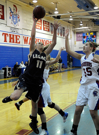 "Legacy High School's Emily Glen takes a shot over Centaurus High School's Andi Houck on Saturday, Dec. 10, during the Boulder Valley Invitational finals at Centaurus. Legacy won the game 53-49. For more photos of the game go to  <a href=""http://www.dailycamera.com"">http://www.dailycamera.com</a><br /> Jeremy Papasso/ Camera"