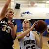 """Andi Houck drives to the hoop past Legacy's Courtney Smith Centaurus High School's on Saturday, Dec. 10, during the Boulder Valley Invitational finals against Legacy High School at Centaurus. Legacy won the game 53-49. For more photos of the game go to  <a href=""""http://www.dailycamera.com"""">http://www.dailycamera.com</a><br /> Jeremy Papasso/ Camera"""