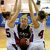 """Legacy High School's Caitlyn Smith gets double teamed by Centaurus High School's Andi Houck, left, and Taylor Langer on Saturday, Dec. 10, during the Boulder Valley Invitational finals at Centaurus. Legacy won the game 53-49. For more photos of the game go to  <a href=""""http://www.dailycamera.com"""">http://www.dailycamera.com</a><br /> Jeremy Papasso/ Camera"""