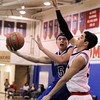 "Longmont High School's Josh Cogdill goes for a lay-up over Centaurus High School's Austin Tunquist Wednesday, Jan. 4, during a basketball game at Centaurus High School in Lafayette. Longmont won the game 46-38. For more photos of the game go to  <a href=""http://www.dailycamera.com"">http://www.dailycamera.com</a><br /> Jeremy Papasso/ Camera"