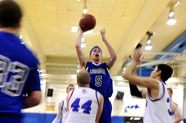 "Longmont High School's Josh Cogdill takes a shot over Centaurus High School's Shane Ellington on Wednesday, Jan. 4, during a basketball game at Centaurus High School in Lafayette. Longmont won the game 46-38. For more photos of the game go to  <a href=""http://www.dailycamera.com"">http://www.dailycamera.com</a><br /> Jeremy Papasso/ Camera"