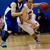 Longmont's Matt Martien (left) follows Centaurus's Will Piers during their game at Centaurus High School in Louisville, Wednesday, Jan. 6, 2009. <br />  <br /> KASIA BROUSSALIAN