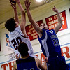 Longmont's Nick Chopp (right) and Jay Knaus (front) jump for the rebound as Centaurus's Kyle Harvey shoots during their game at Centaurus High School in Louisville, Wednesday, Jan. 6, 2009. <br />  <br /> KASIA BROUSSALIAN
