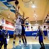 Centaurus's TJ Vasquez (left) goes for a basket while Longmont's Drew Edwards defends during their game at Centaurus High School in Louisville, Wednesday, Jan. 6, 2009. <br />  <br /> KASIA BROUSSALIAN