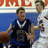 Longmont's Cade Kloster (left) and Centaurus's L.O. Denu run towards the basket during their game at Centaurus High School in Louisville, Wednesday, Jan. 6, 2009. <br />  <br /> KASIA BROUSSALIAN