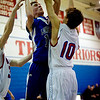 Longmont's Cade Kloster (left) shoots over Centaurus's TJ Vasquez during their game at Centaurus High School in Louisville, Wednesday, Jan. 6, 2009. <br />  <br /> KASIA BROUSSALIAN