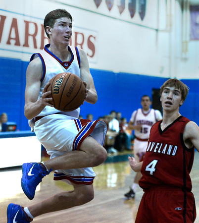 """Centaurus High School's Lance Matosky goes for a layup in front of Brian Strasbaugh during a basketball game against Loveland High School on Friday, Dec. 7, at Centaurus High School. For more photos of the game go to  <a href=""""http://www.dailycamera.com"""">http://www.dailycamera.com</a><br /> Jeremy Papasso/ Camera"""