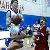 "Centaurus High School's Lance Matosky goes for a layup in front of Brian Strasbaugh during a basketball game against Loveland High School on Friday, Dec. 7, at Centaurus High School. For more photos of the game go to  <a href=""http://www.dailycamera.com"">http://www.dailycamera.com</a><br /> Jeremy Papasso/ Camera"