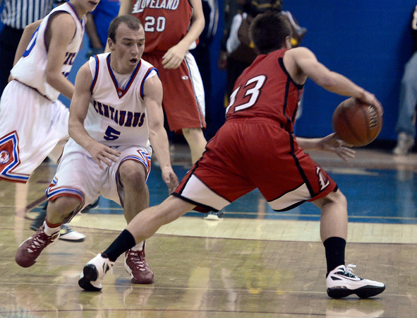 "Centaurus High School's Kyle Taudien tries to guard Joe Etling during a basketball game against Loveland High School on Friday, Dec. 7, at Centaurus High School. For more photos of the game go to  <a href=""http://www.dailycamera.com"">http://www.dailycamera.com</a><br /> Jeremy Papasso/ Camera"