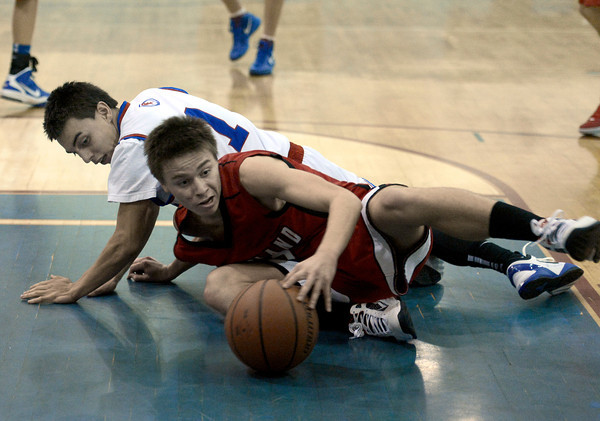 """Centaurus High School's Tony Aguirre, No. 1, fights for a loose ball with Joe Etling during a basketball game against Loveland High School on Friday, Dec. 7, at Centaurus High School. For more photos of the game go to  <a href=""""http://www.dailycamera.com"""">http://www.dailycamera.com</a><br /> Jeremy Papasso/ Camera"""