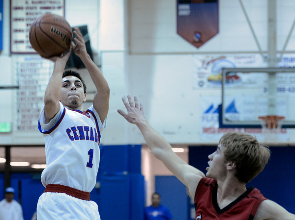 "Centaurus High School's Tony Aguirre takes a shot over Brian Strasbaugh during a basketball game against Loveland High School on Friday, Dec. 7, at Centaurus High School. For more photos of the game go to  <a href=""http://www.dailycamera.com"">http://www.dailycamera.com</a><br /> Jeremy Papasso/ Camera"