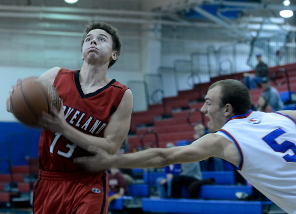 """Loveland High School's Joe Etling drives to the hoop past Kyle Taudien during a basketball game against Centaurus High School on Friday, Dec. 7, at Centaurus High School. For more photos of the game go to  <a href=""""http://www.dailycamera.com"""">http://www.dailycamera.com</a><br /> Jeremy Papasso/ Camera"""