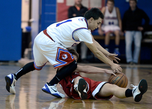 """Centaurus High School's Tony Aguirre fights for a loose ball with Joe Etling during a basketball game against Loveland High School on Friday, Dec. 7, at Centaurus High School. For more photos of the game go to  <a href=""""http://www.dailycamera.com"""">http://www.dailycamera.com</a><br /> Jeremy Papasso/ Camera"""