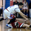 "Centaurus High School's Tony Aguirre fights for a loose ball with Joe Etling during a basketball game against Loveland High School on Friday, Dec. 7, at Centaurus High School. For more photos of the game go to  <a href=""http://www.dailycamera.com"">http://www.dailycamera.com</a><br /> Jeremy Papasso/ Camera"