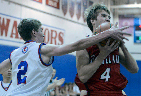"""Loveland High School's Brian Strasbaugh gets fouled by Lance Matosky during a basketball game against Centaurus High School on Friday, Dec. 7, at Centaurus High School. For more photos of the game go to  <a href=""""http://www.dailycamera.com"""">http://www.dailycamera.com</a><br /> Jeremy Papasso/ Camera"""