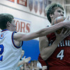 "Loveland High School's Brian Strasbaugh gets fouled by Lance Matosky during a basketball game against Centaurus High School on Friday, Dec. 7, at Centaurus High School. For more photos of the game go to  <a href=""http://www.dailycamera.com"">http://www.dailycamera.com</a><br /> Jeremy Papasso/ Camera"