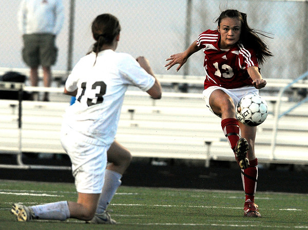 "Centaurus High School's Midori Patterson, right, passes the ball past Monarch High School's Courtney Richard on Friday, March 16, during a soccer game against at Monarch High School in Louisville. Centaurus won the game. For more photos of the game go to  <a href=""http://www.dailycamera.com"">http://www.dailycamera.com</a><br /> Jeremy Papasso/ Camera"