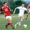 "Centaurus High School's Midori Patterson, left, passes the ball past Monarch High School's Brenna Stimac on Friday, March 16, during a soccer game against at Monarch High School in Louisville. For more photos of the game go to  <a href=""http://www.dailycamera.com"">http://www.dailycamera.com</a><br /> Jeremy Papasso/ Camera"