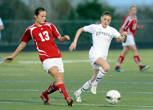 """Centaurus High School's Midori Patterson, left, passes the ball past Monarch High School's Brenna Stimac on Friday, March 16, during a soccer game against at Monarch High School in Louisville. For more photos of the game go to  <a href=""""http://www.dailycamera.com"""">http://www.dailycamera.com</a><br /> Jeremy Papasso/ Camera"""