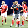 "Centaurus High School goalkeeper Kelly Turcotte, center, hugs teammate Anna Rinaldi after a Centaurus goal on Friday, March 16, during a soccer game against at Monarch High School in Louisville. For more photos of the game go to  <a href=""http://www.dailycamera.com"">http://www.dailycamera.com</a><br /> Jeremy Papasso/ Camera"