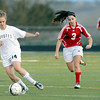 """Monarch High School's Kate Yeash, left, dribbles the ball past Centaurus High School's Danelle Dondelinger on Friday, March 16, during a soccer game against at Monarch High School in Louisville. For more photos of the game go to  <a href=""""http://www.dailycamera.com"""">http://www.dailycamera.com</a><br /> Jeremy Papasso/ Camera"""
