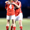 "Centaurus High School's Anna Rinaldi, No. 4, hugs teammate Caitlyn Hughes after a Centaurus goal on Friday, March 16, during a soccer game against at Monarch High School in Louisville. For more photos of the game go to  <a href=""http://www.dailycamera.com"">http://www.dailycamera.com</a><br /> Jeremy Papasso/ Camera"