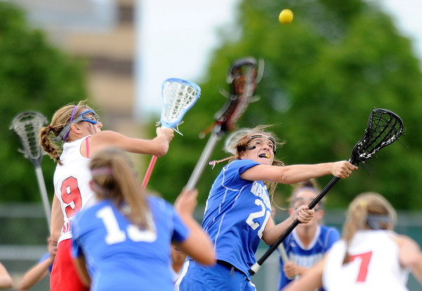 "Centaurus High School's Emma Lazaroff fights for the ball with Regis Jesuit High School's Kat Blumhardt during a lacrosse game on Wednesday, May 16, at Regis Jesuit High School oin Aurora. Centaurus won the game 14-8. For more photos of the game go to  <a href=""http://www.dailycamera.com"">http://www.dailycamera.com</a><br /> Jeremy Papasso/ Camera"