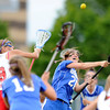 """Centaurus High School's Emma Lazaroff fights for the ball with Regis Jesuit High School's Kat Blumhardt during a lacrosse game on Wednesday, May 16, at Regis Jesuit High School oin Aurora. Centaurus won the game 14-8. For more photos of the game go to  <a href=""""http://www.dailycamera.com"""">http://www.dailycamera.com</a><br /> Jeremy Papasso/ Camera"""