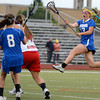 """Centaurus High School's Carley Dvorak takes a leaping shot on goal  during a lacrosse game Regis Jesuit High School on Wednesday, May 16, at Regis Jesuit High School oin Aurora. Centaurus won the game 14-8. For more photos of the game go to  <a href=""""http://www.dailycamera.com"""">http://www.dailycamera.com</a><br /> Jeremy Papasso/ Camera"""