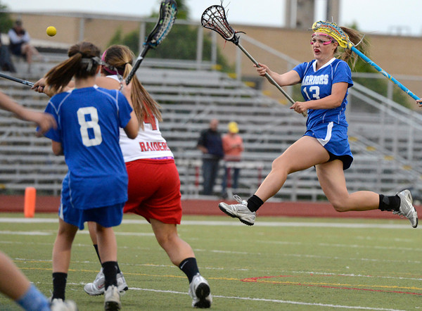 "Centaurus High School's Carley Dvorak takes a leaping shot on goal  during a lacrosse game Regis Jesuit High School on Wednesday, May 16, at Regis Jesuit High School oin Aurora. Centaurus won the game 14-8. For more photos of the game go to  <a href=""http://www.dailycamera.com"">http://www.dailycamera.com</a><br /> Jeremy Papasso/ Camera"