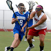 """Centaurus High School's Avery McGiboney rushes toward the goal past Regis Jesuit High School's Maddy Krause during a lacrosse game on Wednesday, May 16, at Regis Jesuit High School oin Aurora. Centaurus won the game 14-8. For more photos of the game go to  <a href=""""http://www.dailycamera.com"""">http://www.dailycamera.com</a><br /> Jeremy Papasso/ Camera"""
