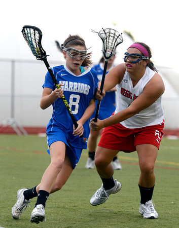 "Centaurus High School's Avery McGiboney rushes toward the goal past Regis Jesuit High School's Maddy Krause during a lacrosse game on Wednesday, May 16, at Regis Jesuit High School oin Aurora. Centaurus won the game 14-8. For more photos of the game go to  <a href=""http://www.dailycamera.com"">http://www.dailycamera.com</a><br /> Jeremy Papasso/ Camera"