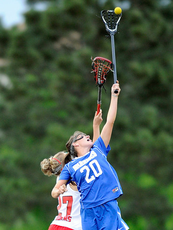 "Centaurus High School's Emma Lazaroff leaps above Regis Jesuit High School's Courtney Gielow to snag the ball during a lacrosse game on Wednesday, May 16, at Regis Jesuit High School oin Aurora. Centaurus won the game 14-8. For more photos of the game go to  <a href=""http://www.dailycamera.com"">http://www.dailycamera.com</a><br /> Jeremy Papasso/ Camera"