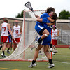 "Centaurus High School's Emma Lazaroff jumps into the arms of Carley Dvorak after scoring a goal against Regis Jesuit High School during a lacrosse game on Wednesday, May 16, at Regis Jesuit High School oin Aurora. Centaurus won the game 14-8. For more photos of the game go to  <a href=""http://www.dailycamera.com"">http://www.dailycamera.com</a><br /> Jeremy Papasso/ Camera"